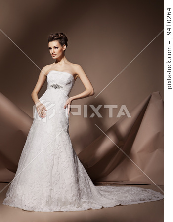 The beautiful young woman in a wedding dress 19410264