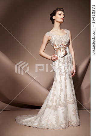 The beautiful young woman in a wedding dress 19410271