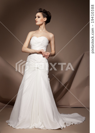 The beautiful young woman in a wedding dress 19410388