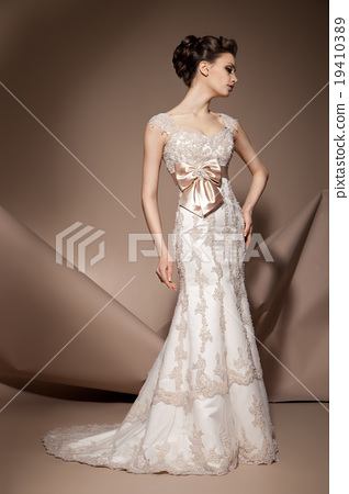 The beautiful young woman in a wedding dress 19410389