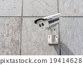 CCTV security camera on stone wall 19414628