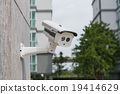 CCTV security camera on stone wall 19414629