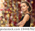 beautiful woman wearing earrings over lights 19446762