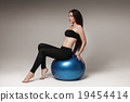 Young attractive woman exersicing with fitness ball 19454414