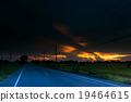 paved country road with surprisingly at sunset. 19464615