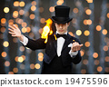 magician in top hat showing trick 19475596