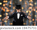 magician in top hat showing trick 19475731