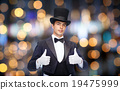 magician in top hat showing thumbs up 19475999