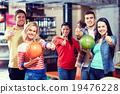 happy friends in bowling club 19476228