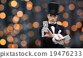 magician showing trick with playing cards 19476233