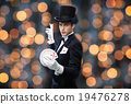 magician showing trick with playing cards 19476278