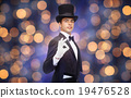 magician in top hat showing ok hand sign 19476528