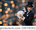 magician showing trick with playing cards 19476563