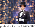 magician in top hat with magic wand 19477087