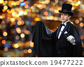 magician in top hat showing trick with magic wand 19477222