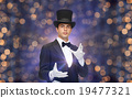 magician in top hat showing trick 19477321