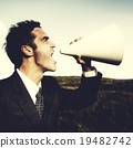 Businessman Shouting Megaphone Field Concept 19482742