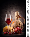 Glass of red wine with decanter and grapes 19540915