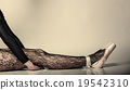 Female legs dancer in ballet shoes 19542310