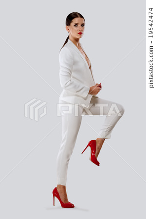 attractive lady in white suit and red shoes , Stock Photo