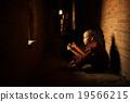 Buddhist novice reading 19566215