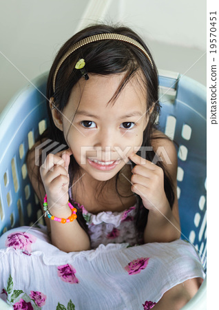 Beautiful Little Asian Girl Playing In Basket