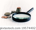 diagram of coins and magnifying glass 19574402