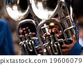 Trombones playing in a big band. 19606079