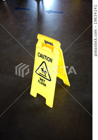 Caution yellow sign for wet floor warning 19634141