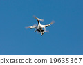 Drone hovering on the blue sky. 19635367