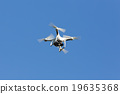 Drone hovering on the blue sky. 19635368