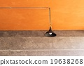 Lamp on the ceiling with cement background. 19638268
