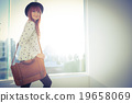 Portrait of a smiling hipster woman with a bag 19658069