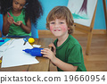 Small boy using arts and crafts supplies 19660954