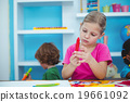 Small girl holding a red crayon 19661092