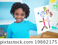 Happy kid enjoying arts and crafts painting 19662175