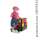 Cute female toddler sitting on a colorful cube 19670432