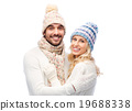 smiling couple in winter clothes hugging 19688338