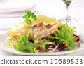 Cheese topped fish fillets with salad 19689523