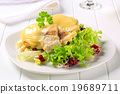 Cheese topped fish fillets with salad 19689711