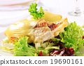 Cheese topped fish fillets with salad 19690161