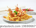 Chicken skewers and French fries 19690667