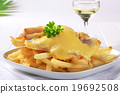 Cheese topped fish fillets with French fries 19692508