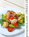 Fish skewer with potato side dish 19692519