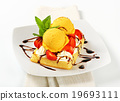 Waffle with ice cream and strawberries 19693111