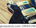 Grungy Electric guitar on wood and vintage effect  19694196