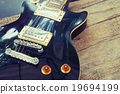 Grungy Electric guitar on wood and vintage effect  19694199