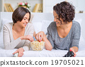 Sisters eating popcorn between videogames. 19705021