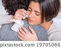Crying woman is hugging her sister.  19705066