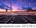 Railroad crossing with car lights in motion. Night 19727812